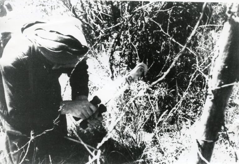 Courier cutting the wire on the former border between Yugoslavia and Italy, Kastav area, around 1945