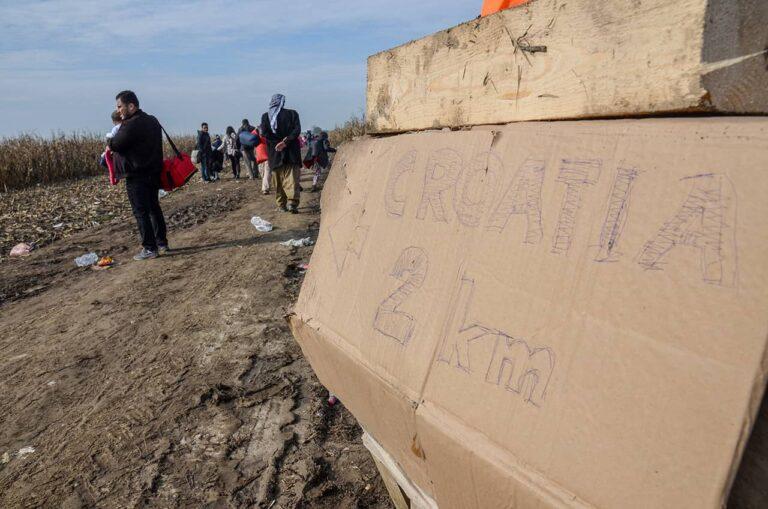 Improvised sign indicating that Croatia is 2 kilometres away, Sanja Vrzić, Croatian-Serbian border, 18 October 2015, Shutterstock